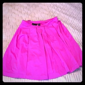 Bright fuchsia pleated skirt